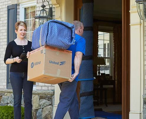 Mover bringing items into a home