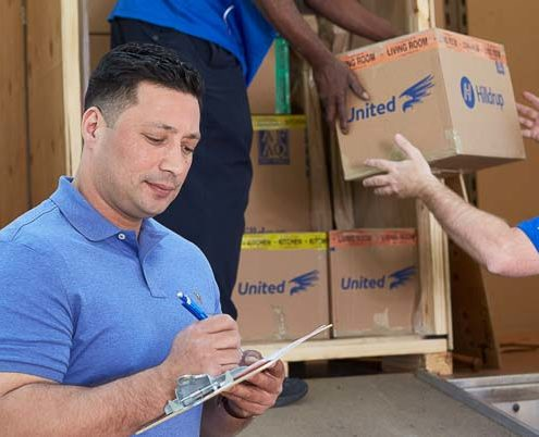 Customer checks off paperwork during a move
