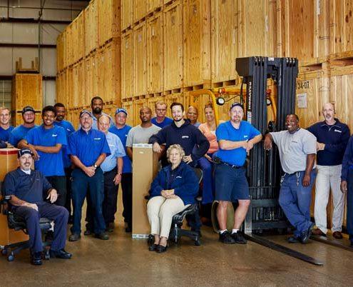 Hilldrup team in a warehouse
