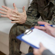 Close up of military member's hands in uniform
