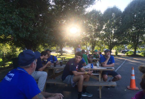 Employees enjoy lunch outside