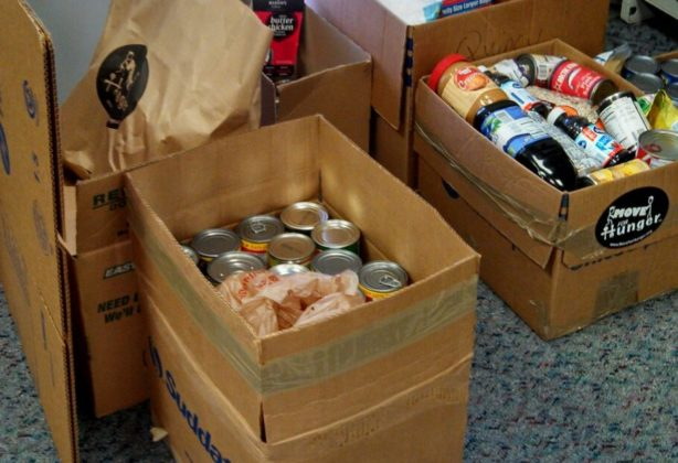 Donated canned goods in boxes