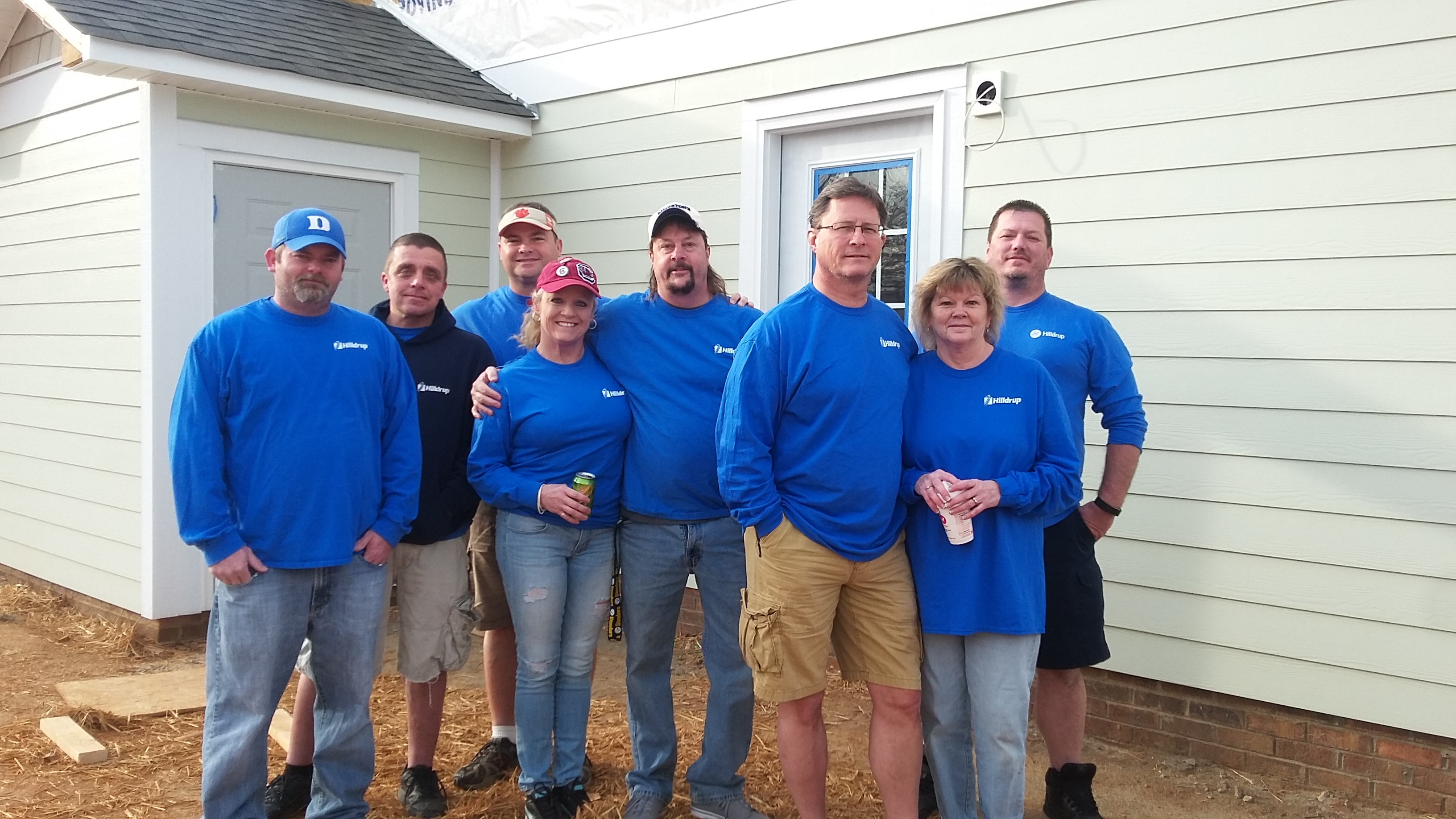 Team assisting with building a home