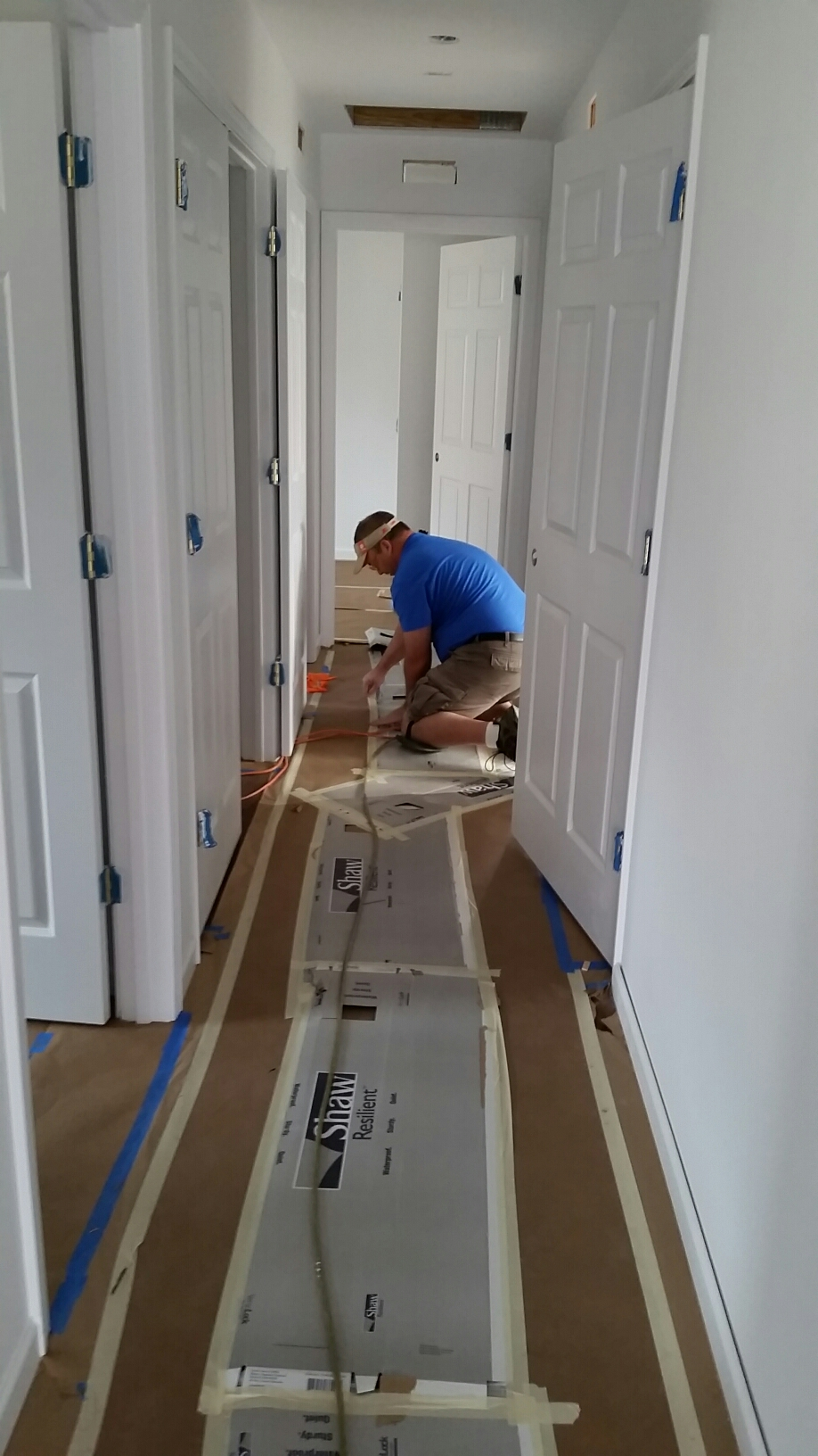 Hilldrup team installing floor protection in home