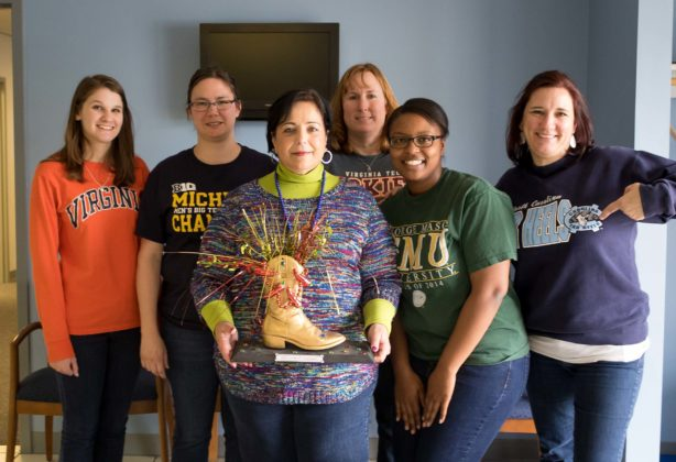 Chilo Cook off participants with trophy