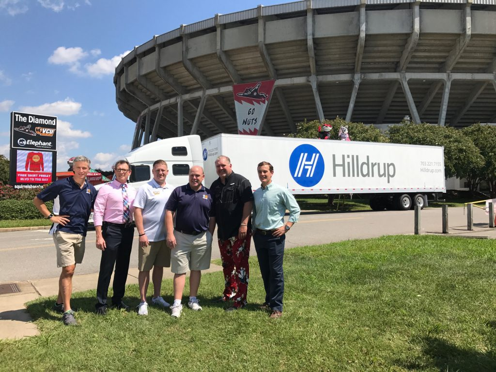 Team outside of stadium with Hilldrup truck