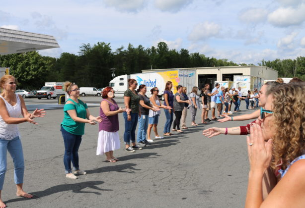 Employees line up to participate in water balloon toss
