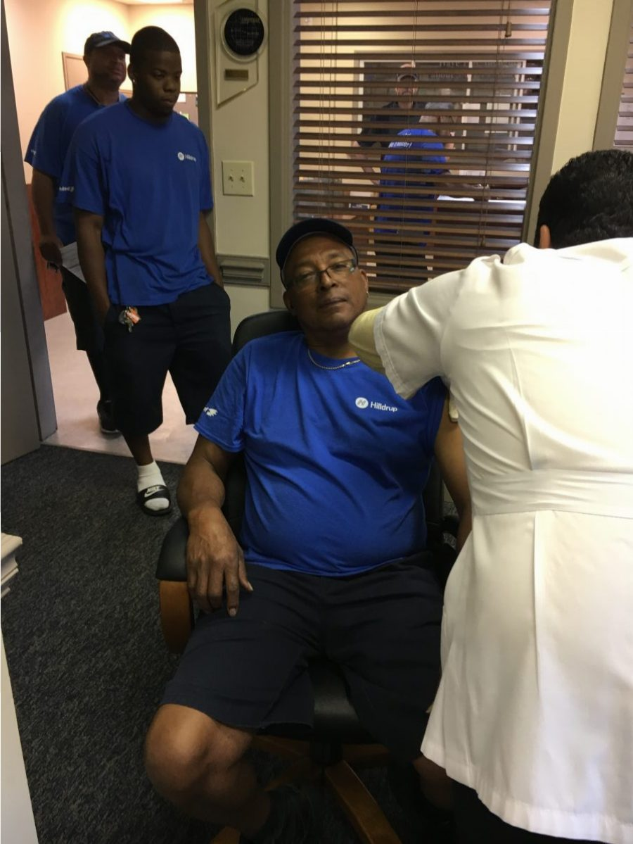 Employee receives flu shot