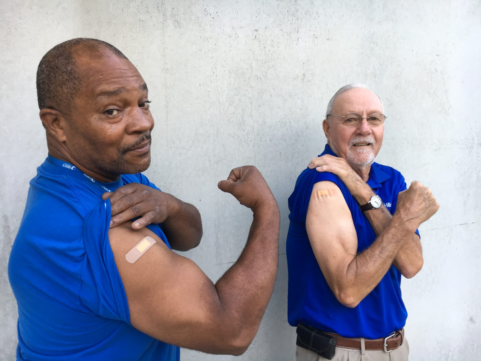 Employees flexing their arms