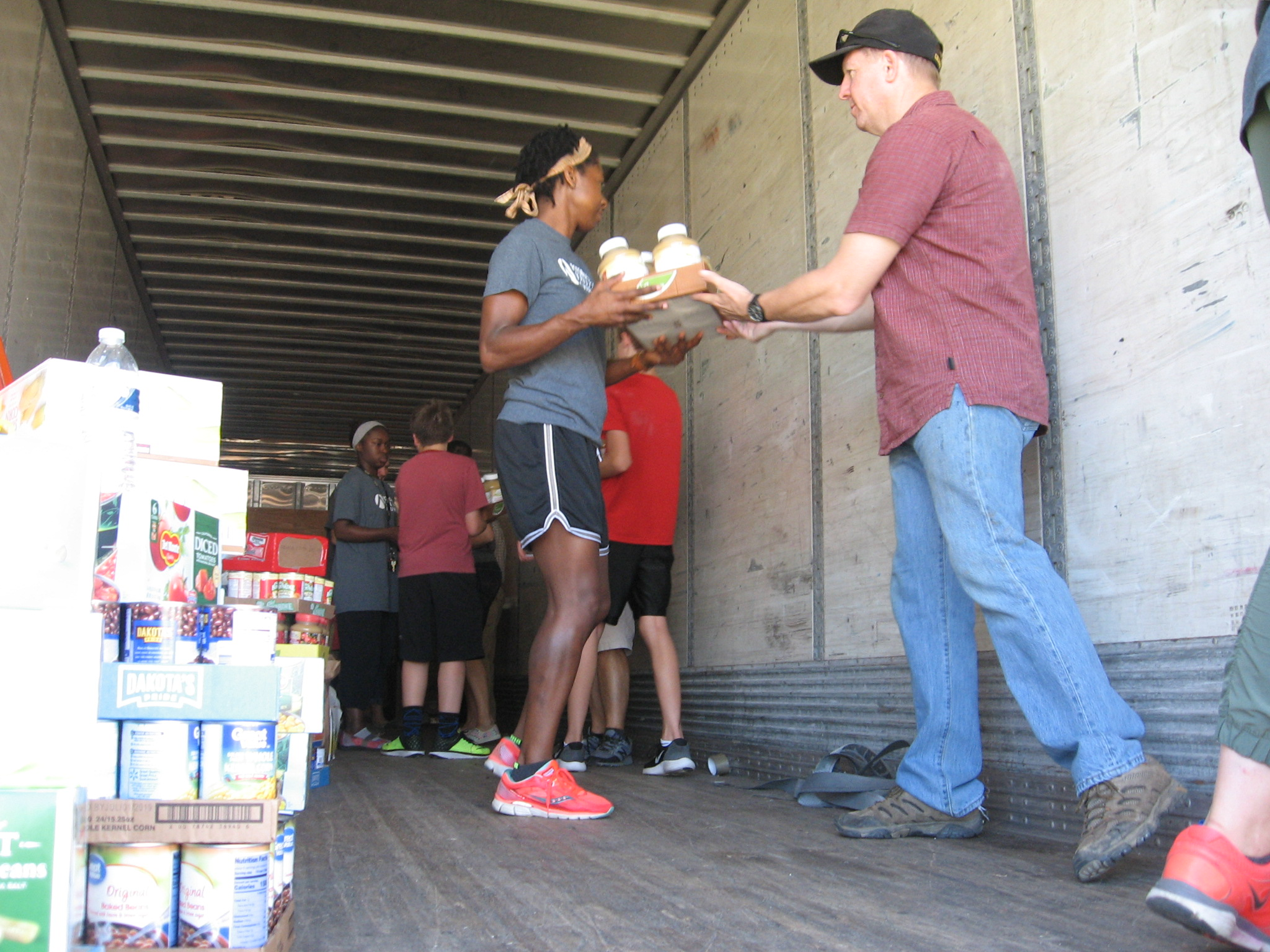 Teams work to load donated items into truck