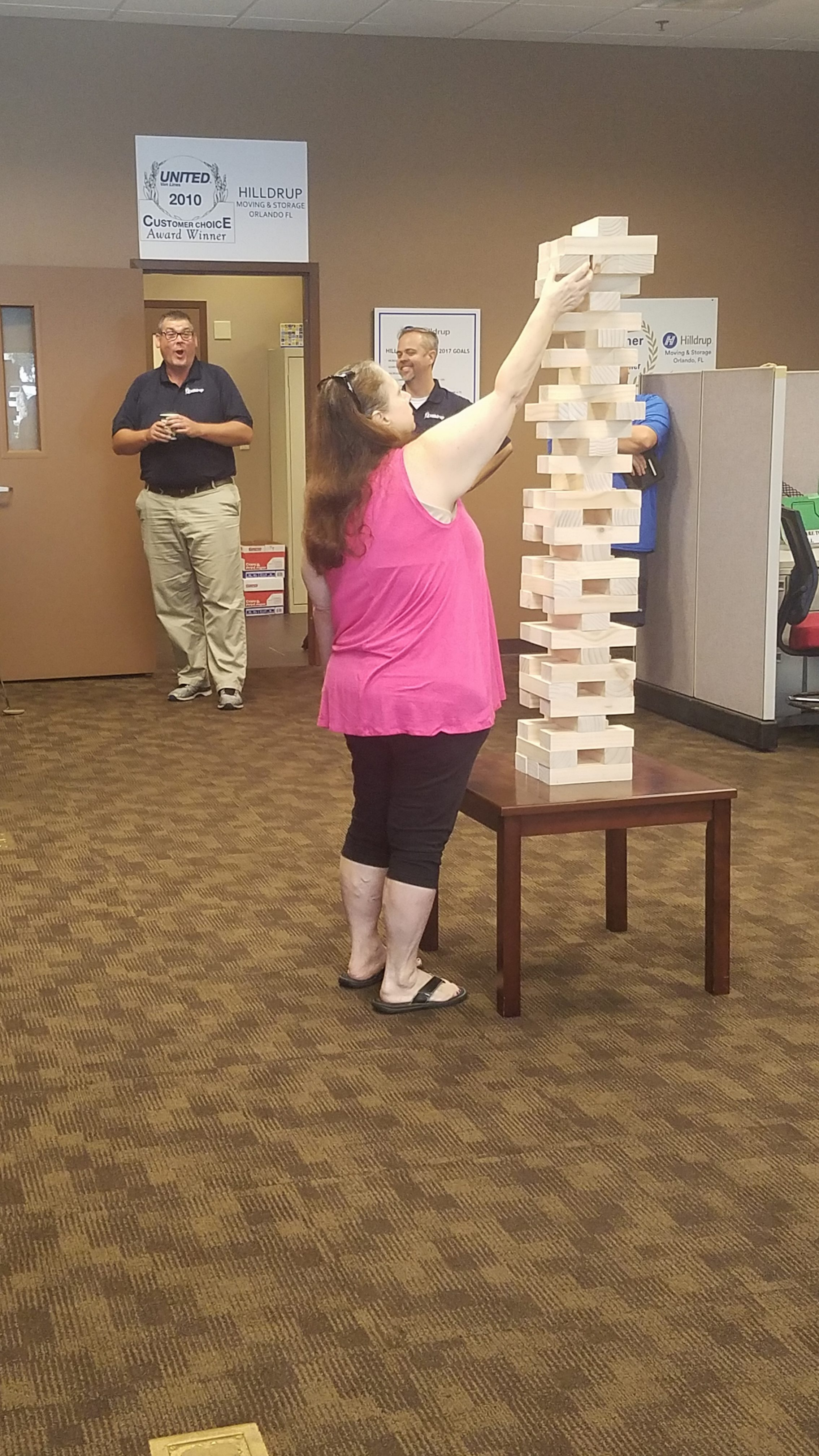 Employee plays Jenga