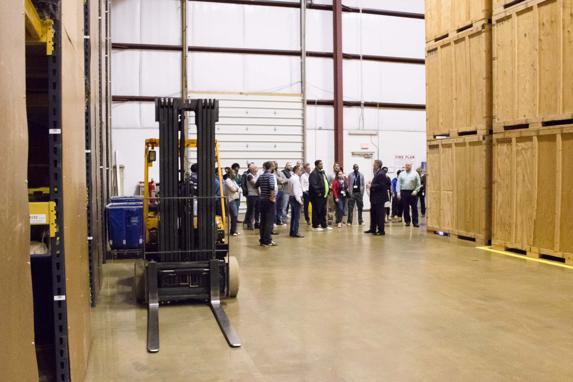 State Dept visit in warehouse