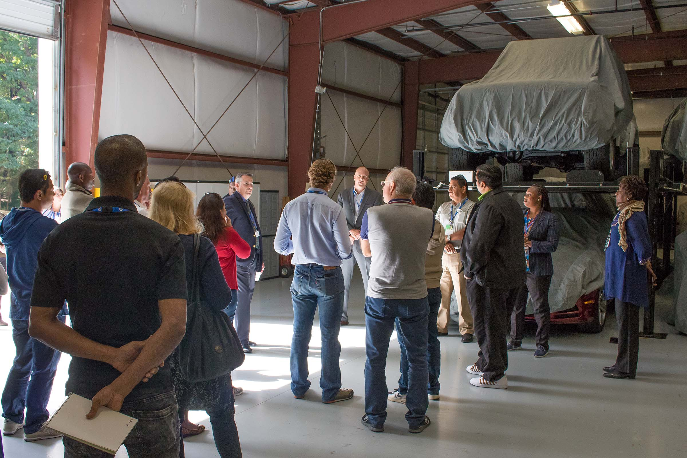 State Dept visit at car warehouse