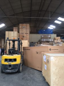 Jordan and Charlie McDaniel in Peru warehouse