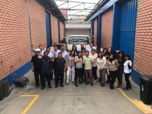 Jordan and Charlie McDaniel with moving and storage company employees in Peru