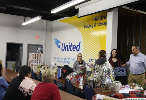 Hilldrup employees prepare to share winning names of raffle numbers
