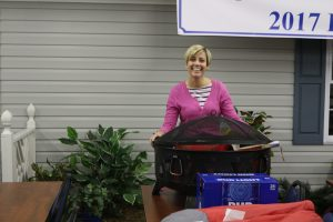Chrissy Gregath with a firepit that she won