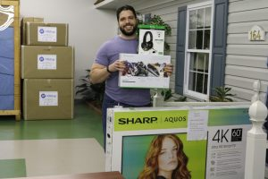 Walt Moe who won a 60 inch TV and XBOX accessories