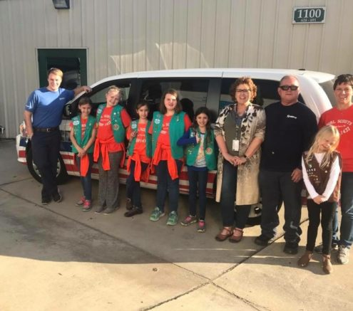 Hilldrup employees with girl scouts at candy drive