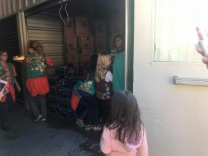 Girl scouts assisting with candy drive