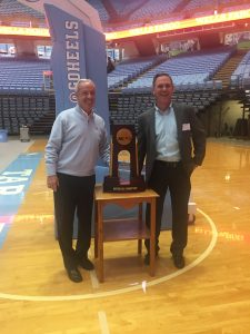 Hilldrup employee with UNC trophy