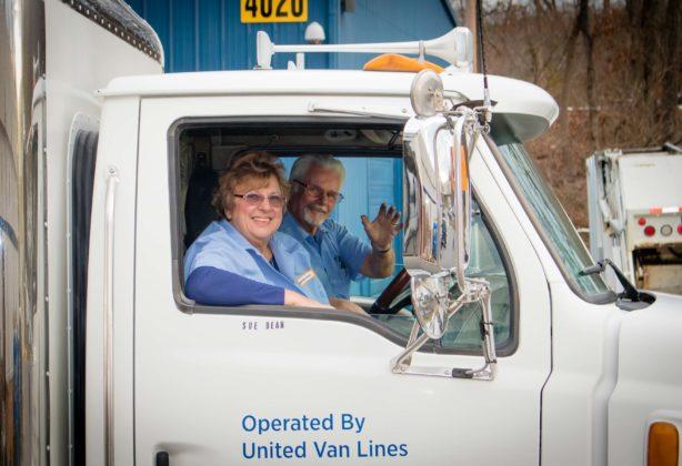 Joe and Sue Dean riding in Hilldrup truck