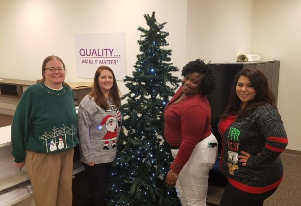 Hilldrup Atlanta wearing Christmas sweaters