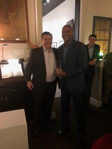 Nigel Kelly accepts sales award from Tom Hinkley