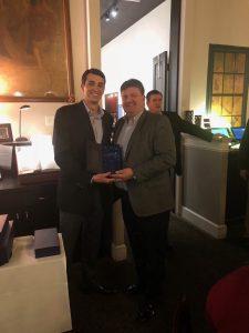 Rick Barnett accepts sales award from Charlie McDaniel