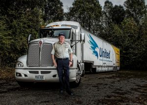 Johnny Abbott in front of his truck