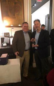 Sales Award presented to employee from John Lohmeyer