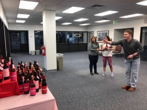 Employees play for a chance to win a wine