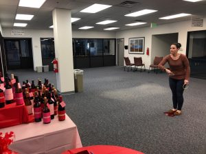 Hilldrup employees plays ringtoss for a chance to win bottle of wine