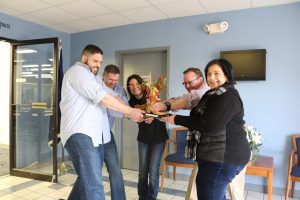 Employees pretend to fight over Chili Cook Off trophy