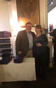 Mary Katherine accepts sales award from John Lohmeyer