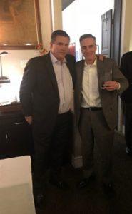 Rick Barnett presented with sales award from Tom Hinkley