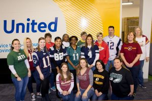 Employees sport their favorite team's jerseys