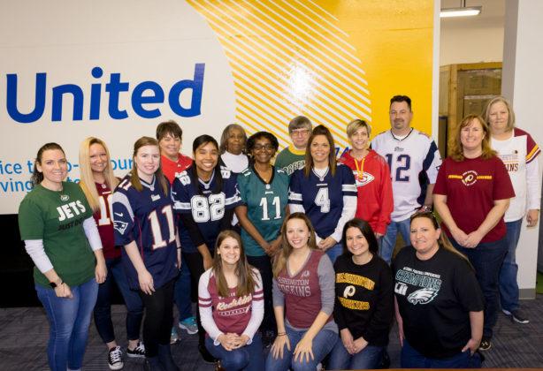 Employees sport their favorite team's jerseys