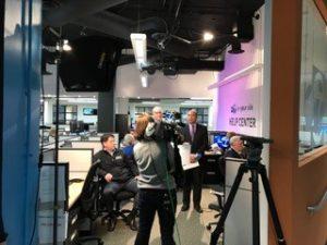 Live recording of TV news program in studio