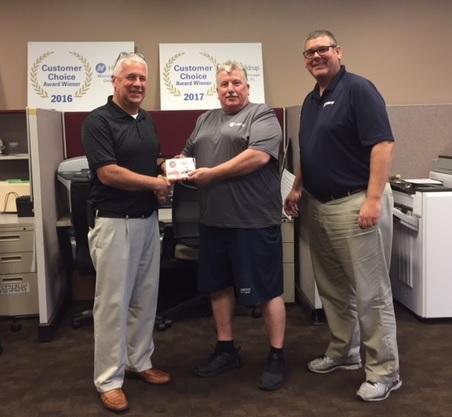 Hilldrup Orlando presenting awards to employees