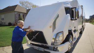 Bob Fitzgerald inspecting truck