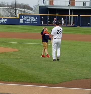 Boy highfives baseball player at UVA game
