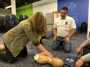 Hilldrup employee learns CPR on dummy