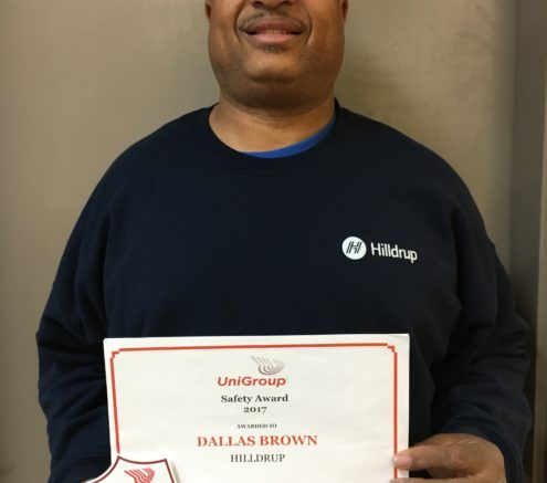 Dallas Brown with award from UniGroup
