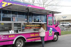 Woman orders from food truck