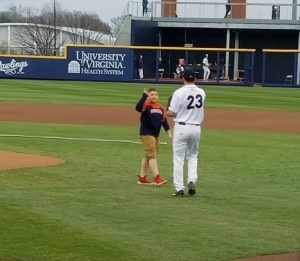 Boy high-fives baseball player at UVA game
