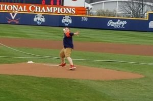 Boy throws first pitch at baseball game