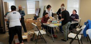 Volunteers sorting books