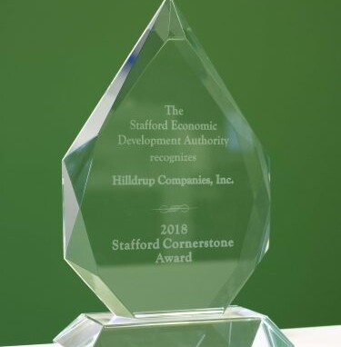 2018 Stafford Economic Development Authority Cornerstone Award in front of a green wall