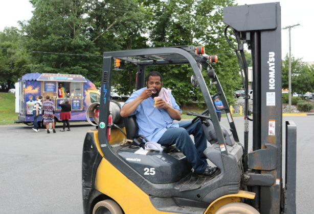 Russell Hall enjoying some Kona Ice during a break from working the forklift